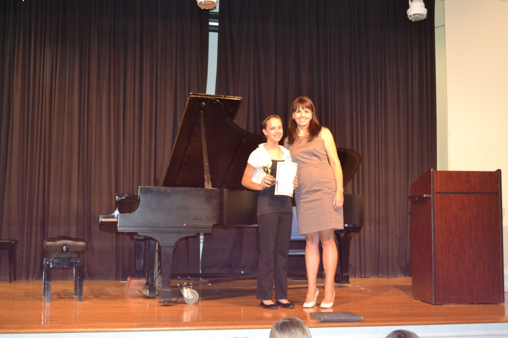 Eliza received a trophy from the Federation of Music Clubs