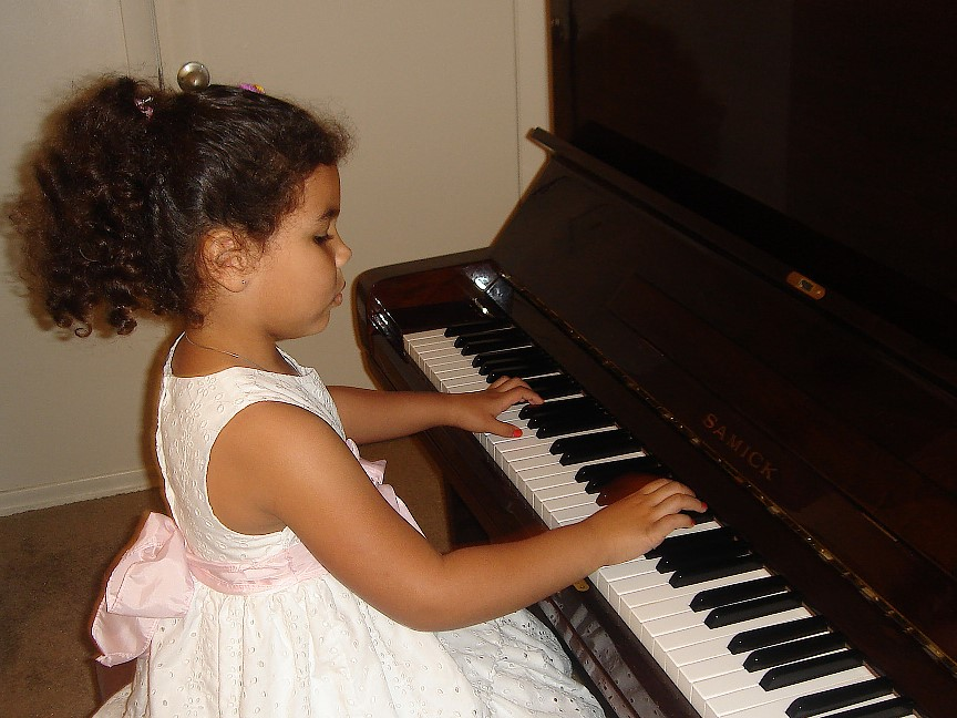 Stefa at the piano lesson