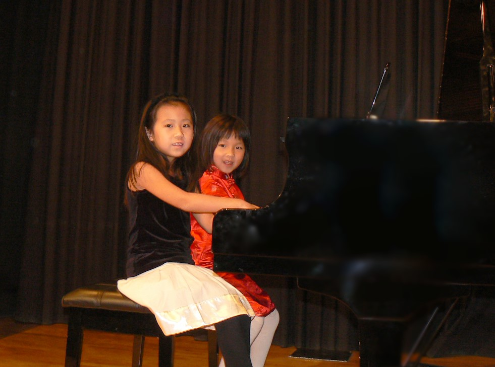 Sophia and Jessica at the piano recital