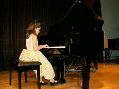 Olympia at the piano recital